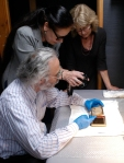 Peter Mustardo, Nora Kennedy, and Toddy Munson examine the deterioration on the exposed plate.