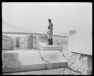 Stone mason on Manhattan Bridge